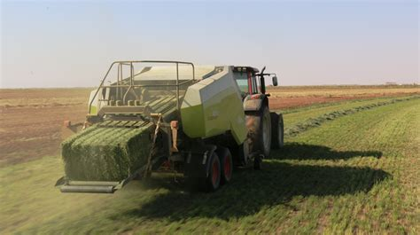 Silage Bale and Tractor in Field Image